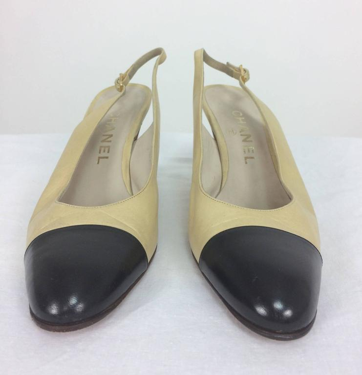 Vintage Chanel classic bone and black sling back pumps 38...Classic style with adjustable buckle 3