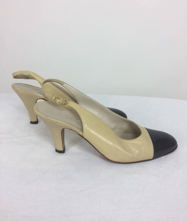 Brown Vintage Chanel classic bone and black sling back pumps 38 For Sale