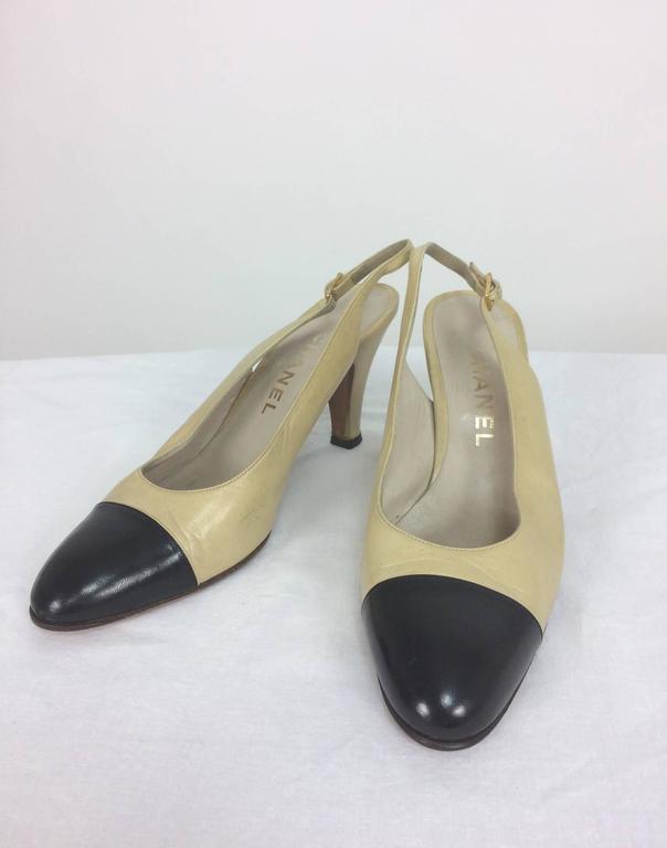 Women's or Men's Vintage Chanel classic bone and black sling back pumps 38 For Sale