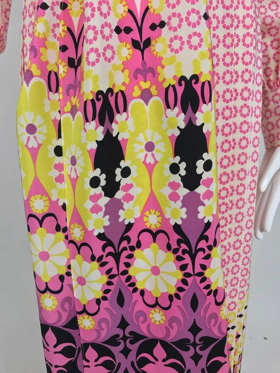 Martha Boutique (Palm Beach) silk border print pleated maxi dress from the 1970s...Button front dress has wide collar closes at the front with covered buttons and loops...Long sleeves have deep cuffs and close with 3 buttons each...The attached