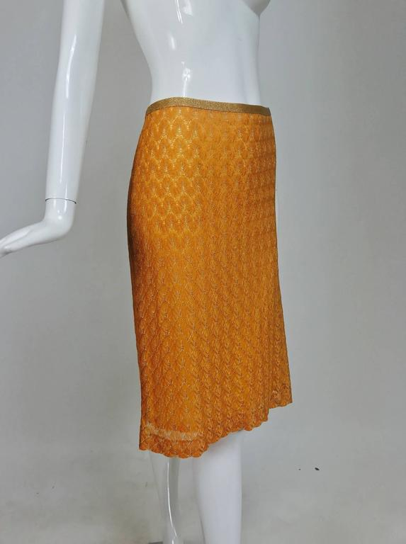 Missoni coral and gold metallic knit straight skirt...Gold metallic knit waist band...Fully lined...Center back kick pleat...Closes with a zipper and hook and eye at the back...Unworn new without tags...Marked size 44, measurements below.  In