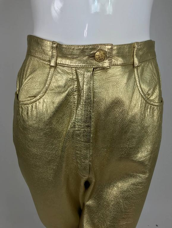 Ferragamo soft gold leather jeans style trousers from the 1980s...Fly front with button waist and scoop front pockets, yoke back there are no back pockets...Bright gold leather, these trousers sit at the natural waist and are fitted through the hip,