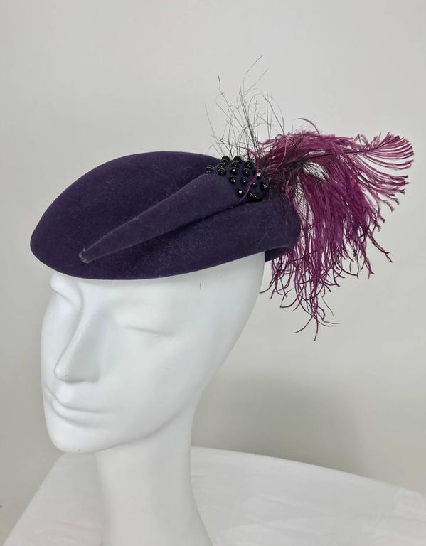 Vintage Mr John purple wool beaded and feather cocktail hat 1950s...Fabulous hat with lots of style, worn sitting at the front of the head, there is an elastic cord that was originally worn at the back under your hair...The hat has a felt decoration