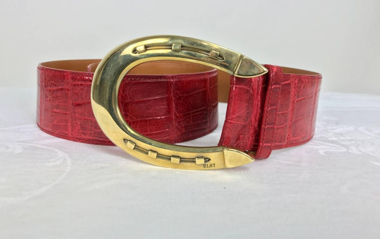 """Fabulous red alligator belt with gold horseshoe buckle from Ralph Lauren...In excellent condition, looks unworn... Measurements are: 2"""" high 40"""" long end to end belt only add 4 1/2"""" for buckle 3 1/4"""" wide buckle 4 1/2"""" long buckle"""