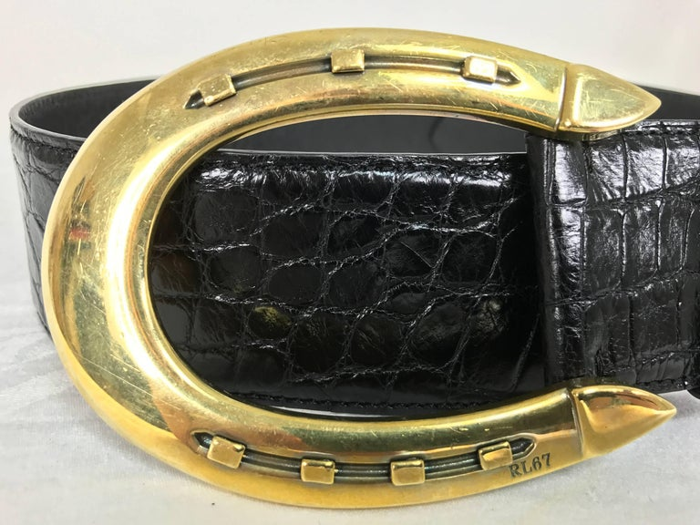 "Beautiful Ralph Lauren glazed black alligator belt with a heavy gold horseshoe buckle marked size medium...In excellent condition, looks unworn. Measurements are: 2"" wide 40"" long belt end to end add 4 1/4"" for buckle 3"" wide buckle 4 14"" long"