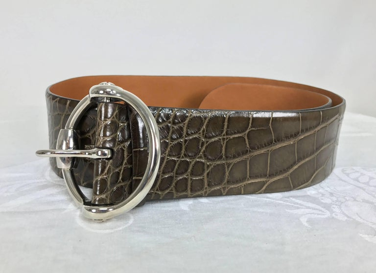 Beautiful wide brown alligator belt with a round heavy silver buckle from Ralph Lauren...Marked size medium...In excellent condition looks unworn...Has a slight contour. Measurements are: 2 1/2