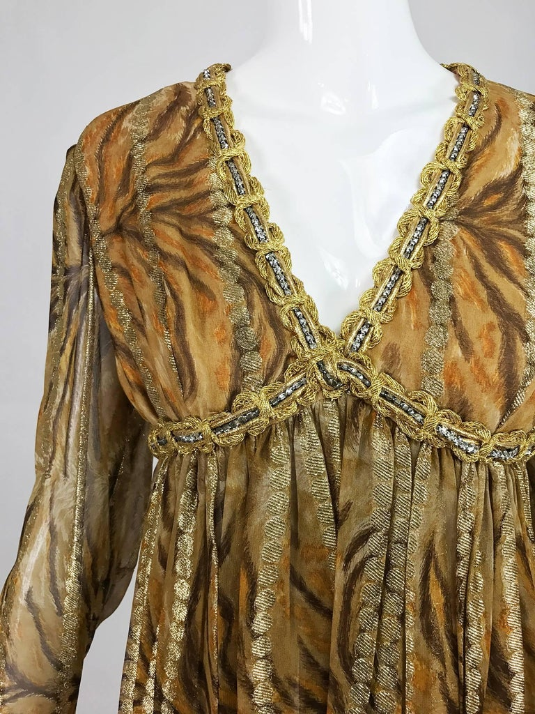 Fabulous Bill Blass golden metallic stripe silk chiffon, tiger print cocktail dress with gold cord and crystal rhinestone trim at the deep V neckline, under bust band and cuffs...The skirt is open pleats that fall from the high waist bodice...Long