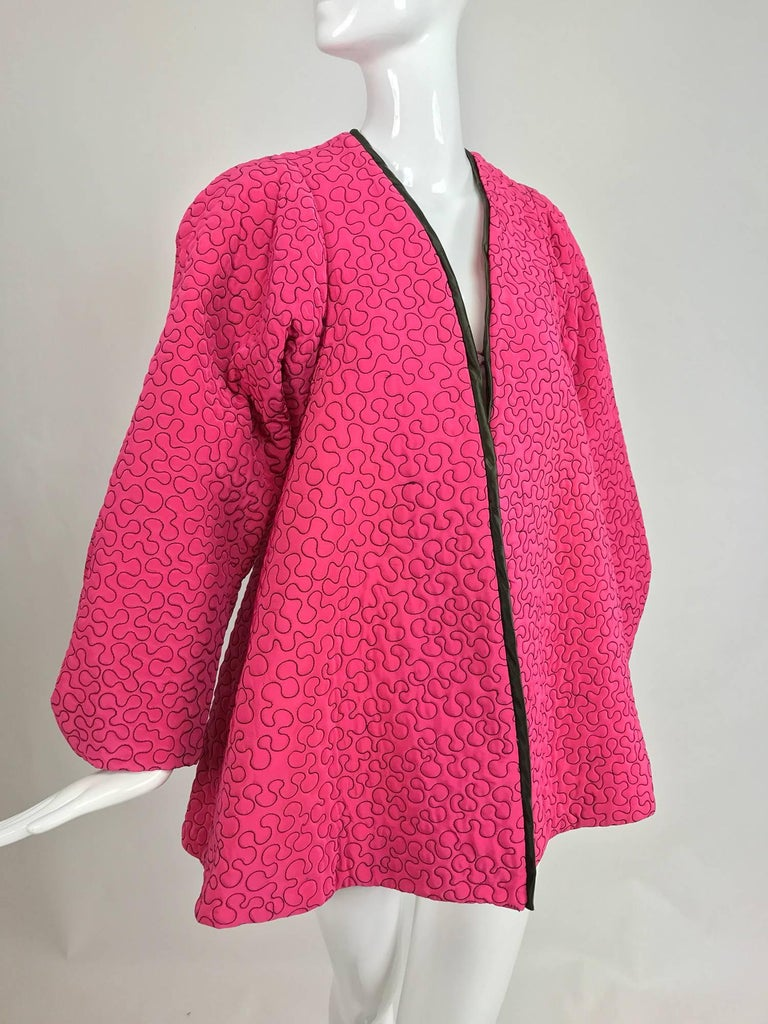 Zandra Rhodes 1980s hot pink squiggle quilted swing jacket...Hot pink rayon is quilted with black thread in an allover squiggle pattern...The jacket closes at the front with a hidden hook and loop and is open below, facings are black satin...The