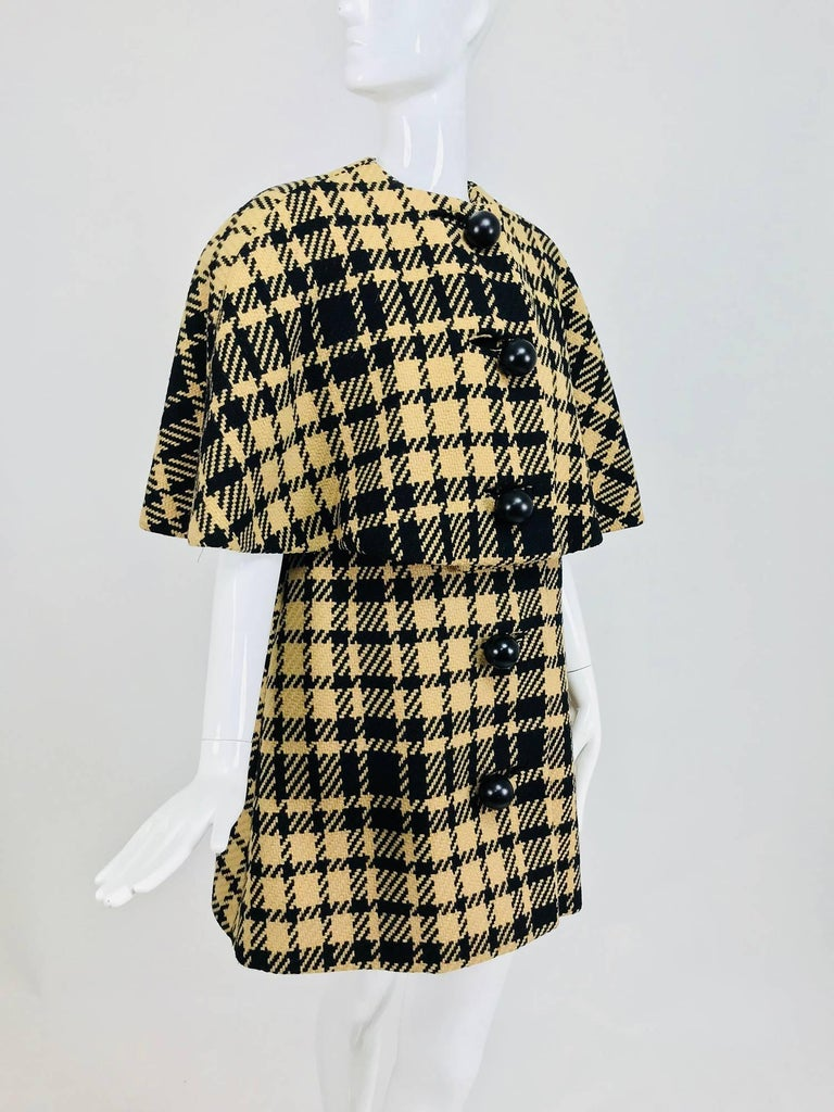 Rudi Gernreich vintage 1960s mod black and tan wool houndstooth plaid mini cape tent coat...Over sized houndstooth pattern is woven in black with a tan ground, the wool is a chunky weave...This piece has fabulous Bakelite buttons, the outer buttons