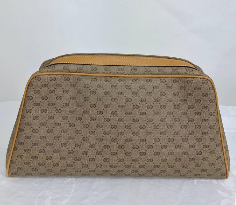 Brown Vintage Gucci logo coated canvas and leather clutch 1980s For Sale
