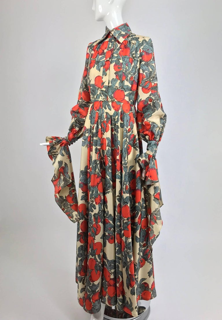 John Bates iconic apple print dress for Jean Varon 1970s...Fantastic print on a dress of acetate twill (feels like silk), the design is so evocative of the period!  Button front fitted bodice dress has self covered buttons, closes high at the neck