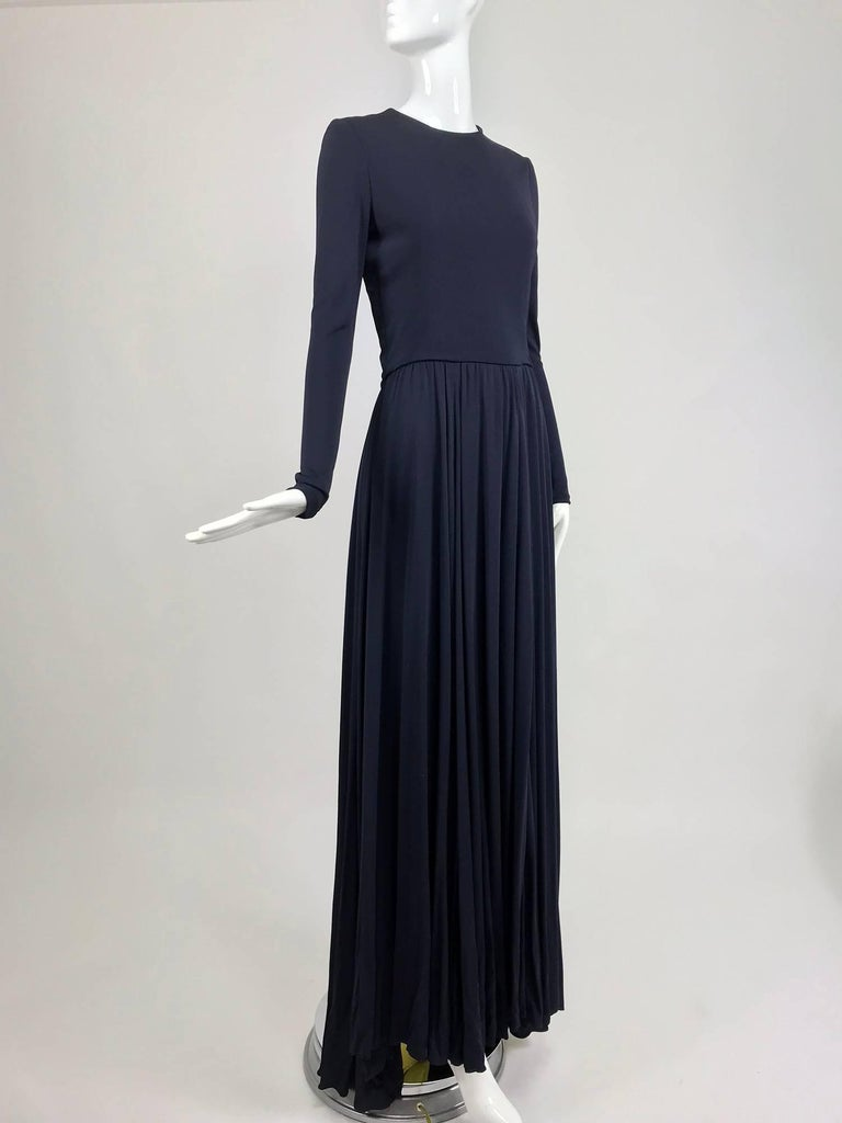 Carolina Herrera sample navy blue and yellow matte jersey evening dress...From the front this dress is a picture of simplicity with its understated design, but from the back it's a real surprise with two hip back inset panels of bright yellow
