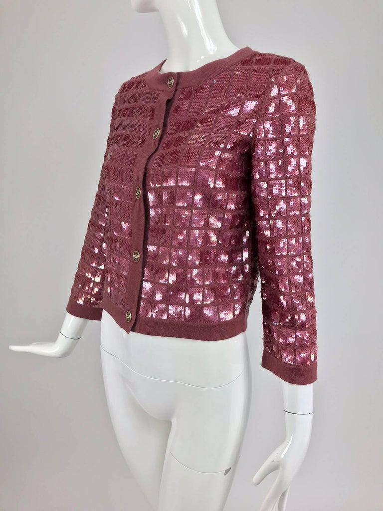 Chanel raspberry sequined cashmere sweater 2008...Cardigan sweater with grid design sequins...100% cashmere...Sequins are very glittery...Unlined...Marked size 36...  In excellent wearable condition... All our clothing is dry cleaned and inspected