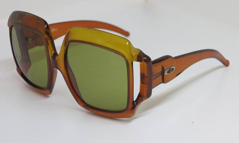 "Christian Dior dark amber big square sunglasses from the 1970s...Approximately 6 1/8"" wide x 3"" high 5 3/4"" side piece front to back...In excellent condition, lenses with extremely light wear, lenses are amber/brown colour."