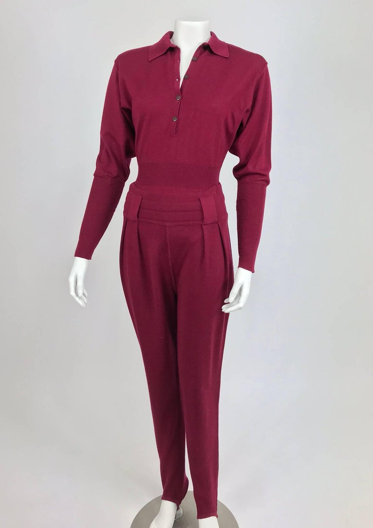 Azedine Alaia 1980s burgundy wool knit body suit and stirrup trousers from the 1980s...An early example of Alaia's work this two piece set is done in Burgundy fine wool knit...The body suit hugs the body, pull on style with a button front placket,