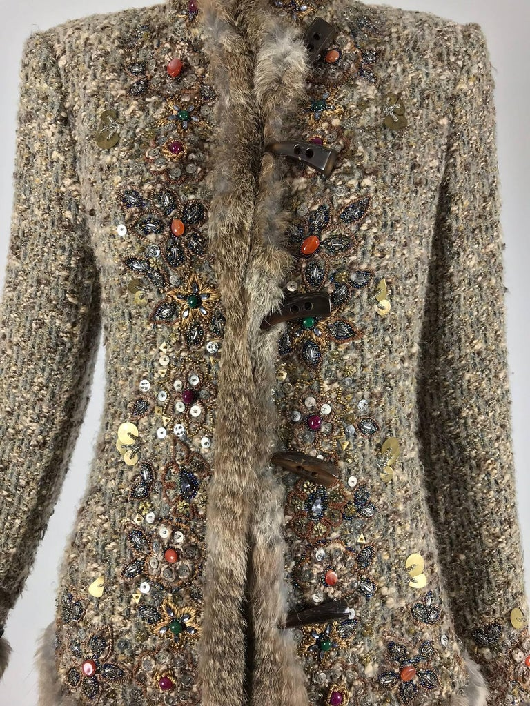 Oscar de la Renta jewel and fur trim soft tweed knit skirt set...Beautiful Jacket and skirt set in rich warm tones of brown, the fabric is a soft knit...The jacket and the skirt are trimmed with coloured jewels, metal sequins of different shapes and