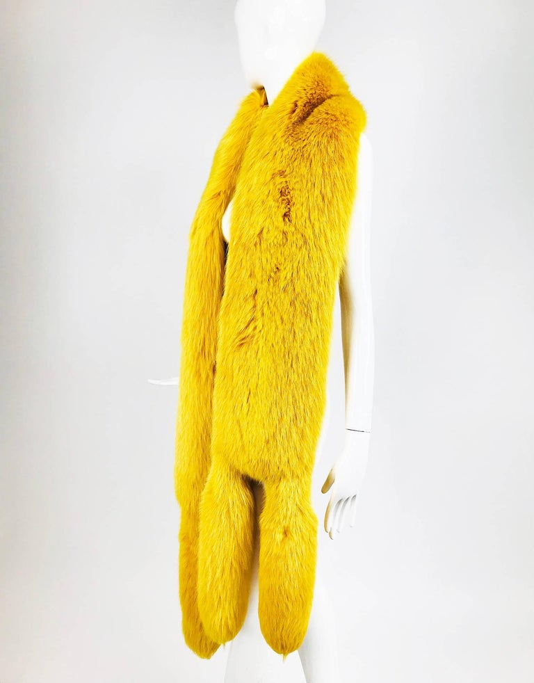 Saffron yellow fox fur stole with tails 1980s...Beautiful and unusual, this stole is wide and long...The fur is thick and in excellent condition...Lined in Saffron cut velvet and brocade...  In excellent wearable condition... All our clothing is dry