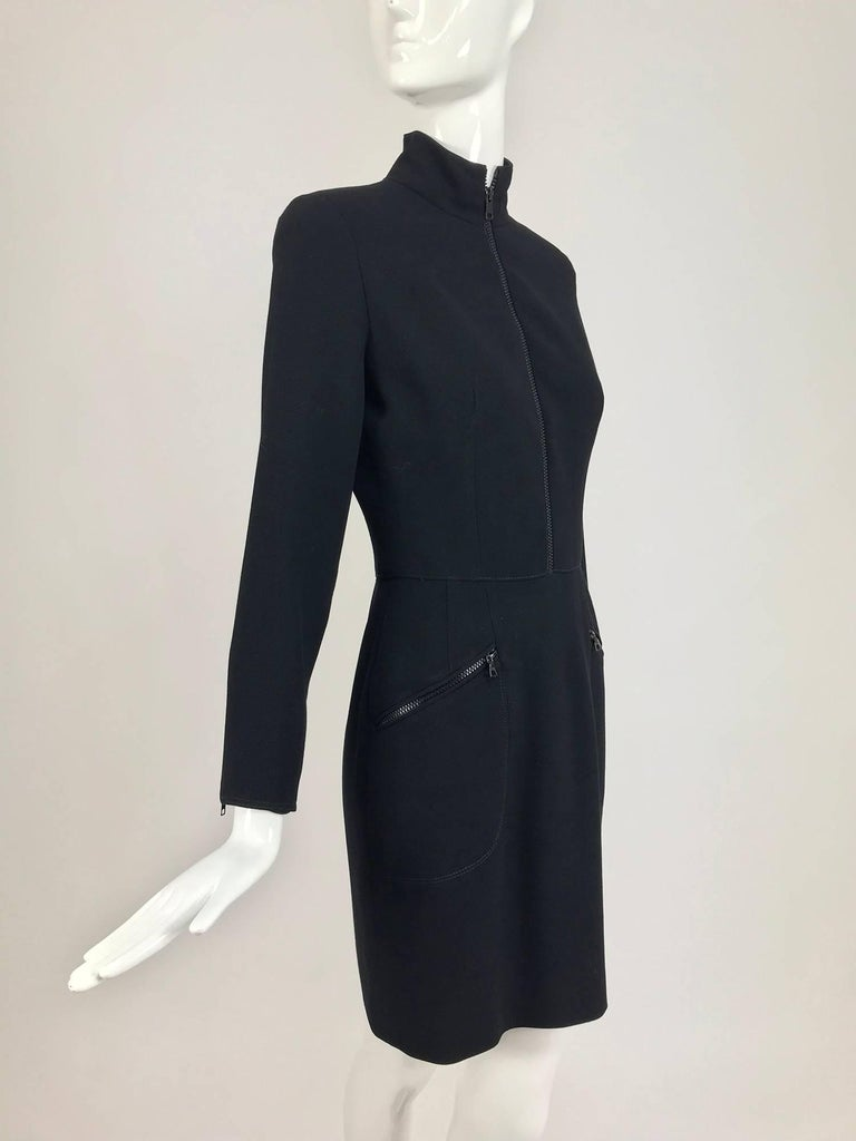 Vintage Valentino fitted light weight black wool twill big zipper dress from the 1990s...Fitted bodice has vertical bust darts and a mock neck, long tapered sleeves with oversize black zippers at each cuff...The pencil skirt is attached at the waist