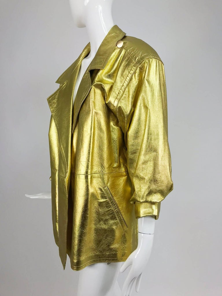Lillie Rubin gold leather jacket from the 1980s...Soft gold leather jacket looks barely, if ever worn, the jacket has notched lapels, no front closures and looks good belted...3/4 length sleeves have banded cuffs...Yoke shoulder back...Angled front