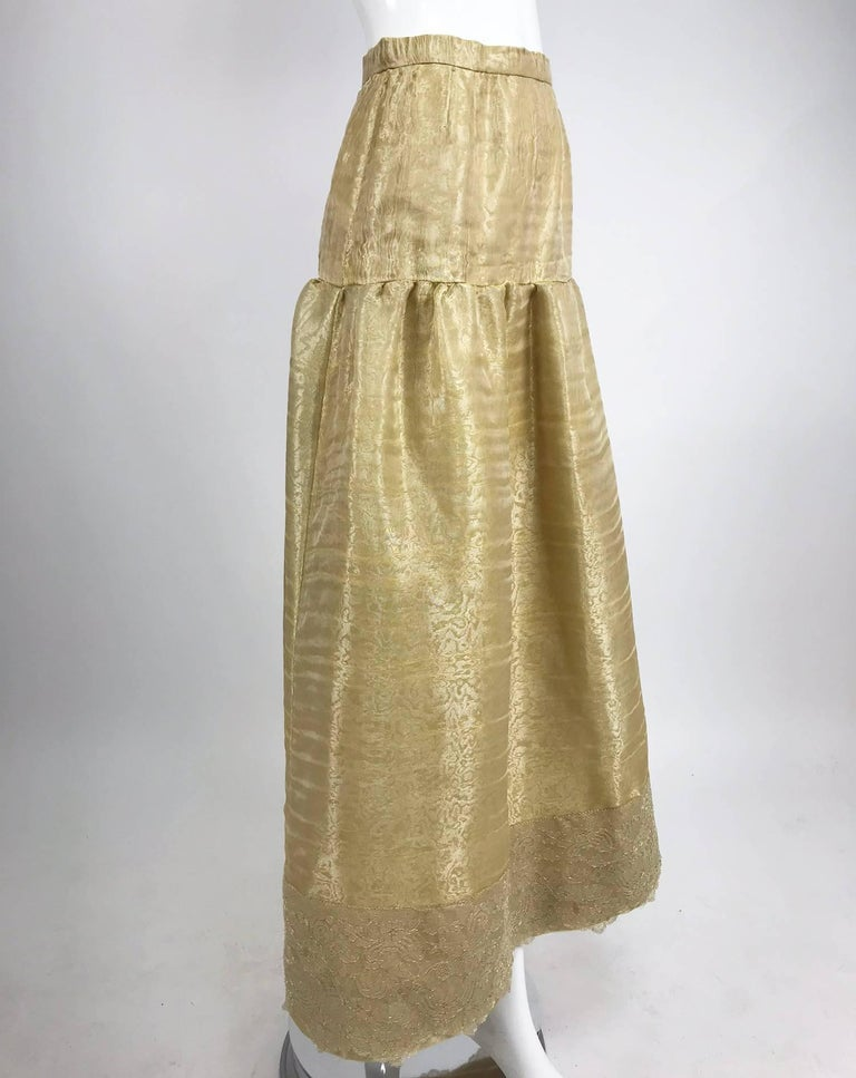 Emanuel Ungaro Studio Couture gold spun silk evening skirt...This beautiful skirt is made of the most amazing fabric, loosely woven silk organza which is interlined with silk organza, the skirt is lined in gold silk satin...Yoke top skirt is lightly