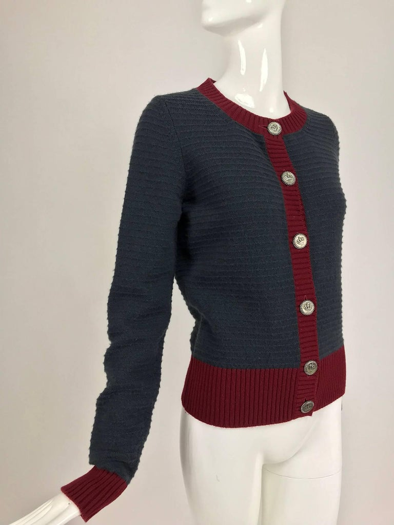 Chanel grey and wine cashmere cardigan sweater...Horizontal rib knit sweater closes with gunmetal grey crown Chanel buttons...Marked size 40...   In excellent wearable condition... All our clothing is dry cleaned and inspected for condition and is