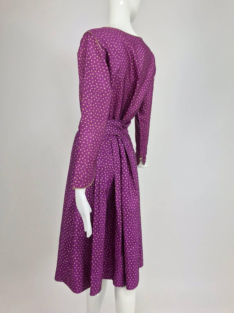 Yves Saint Laurent fuchsia silk with gold print top, skirt and belt from the 1970s...Amazing colour and the print really pops!  The button front long sleeve blouse has a scoop neckline with gold cord trim and gold buttons at the front, the shaped