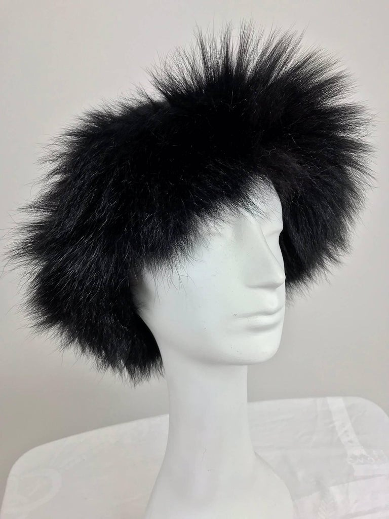 Lillie Rubin black fox fur and gold metallic knit hat from the 1970s...Knitted cap with a band of full fluffy fox fur around the edge...Unlined...Fits size Small-Medium.