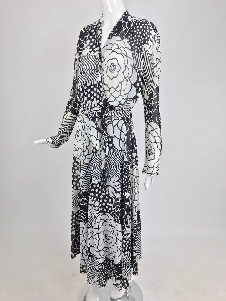 Gottex black and white jersey wrap dress from the 1980s. I love this graphic print that has an Art Deco vibe. A wrap front dress with long, fitted at the wrist sleeves, a narrow narrow shawl collar and long wrap ties at the waist, the skirt is long