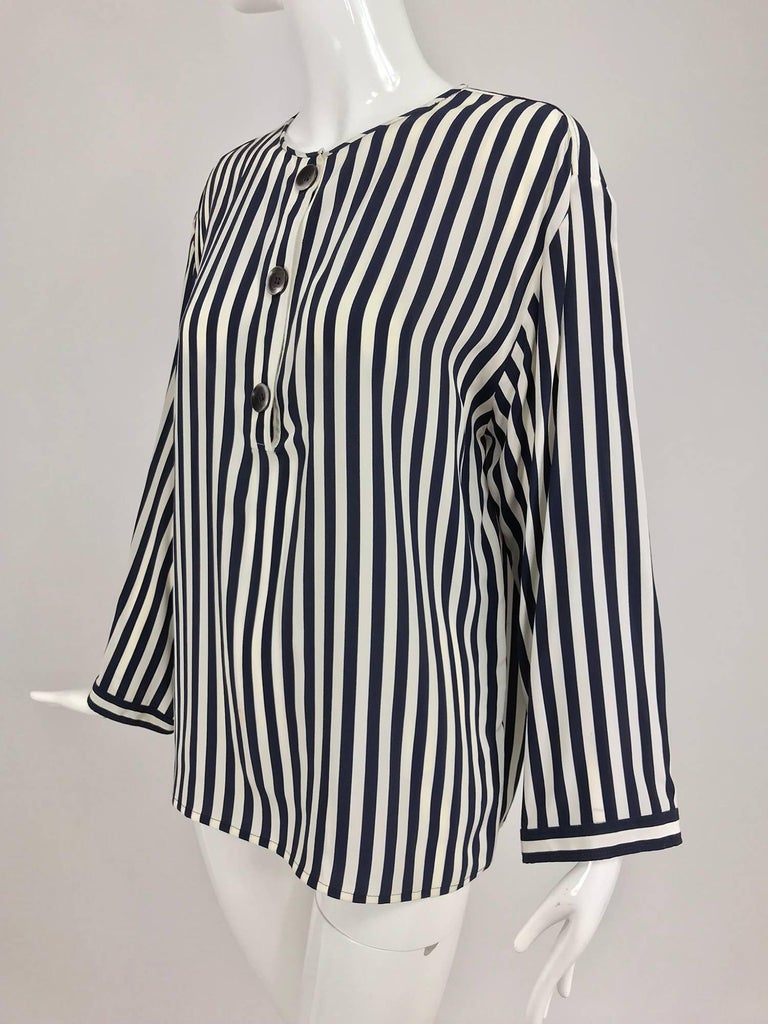Valentino Navy blue and white stripe silk blouse, long sleeve, yoke back blouse has a placket button front mother of pearl buttons. Round rolled neck. Pull on style blouse is unlined. Marked size 10. In excellent wearable condition... All our