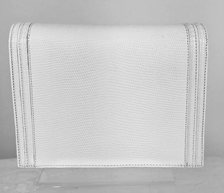 Lana of London white envelope style lizard clutch with gold hardware. Beautiful bag in textured lizard, matte gold hardware, lined in white leather with a single zipper compartment. In very good condition, missing the shoulder strap. There are some