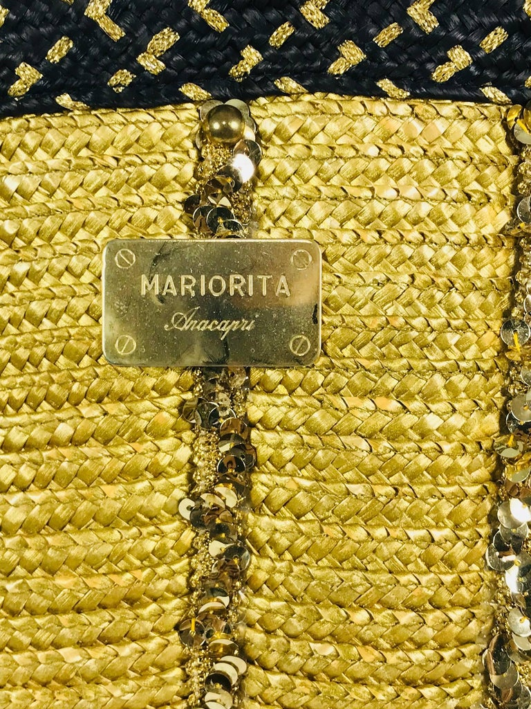 Mariorita Anacapri natural straw tote bag from the 1980s. Scalloped natural golden straw bag is trimmed with gold sequins. The top of the bag is done in a band of woven black straw and gold cord.  The bag has double shoulder straps that are black
