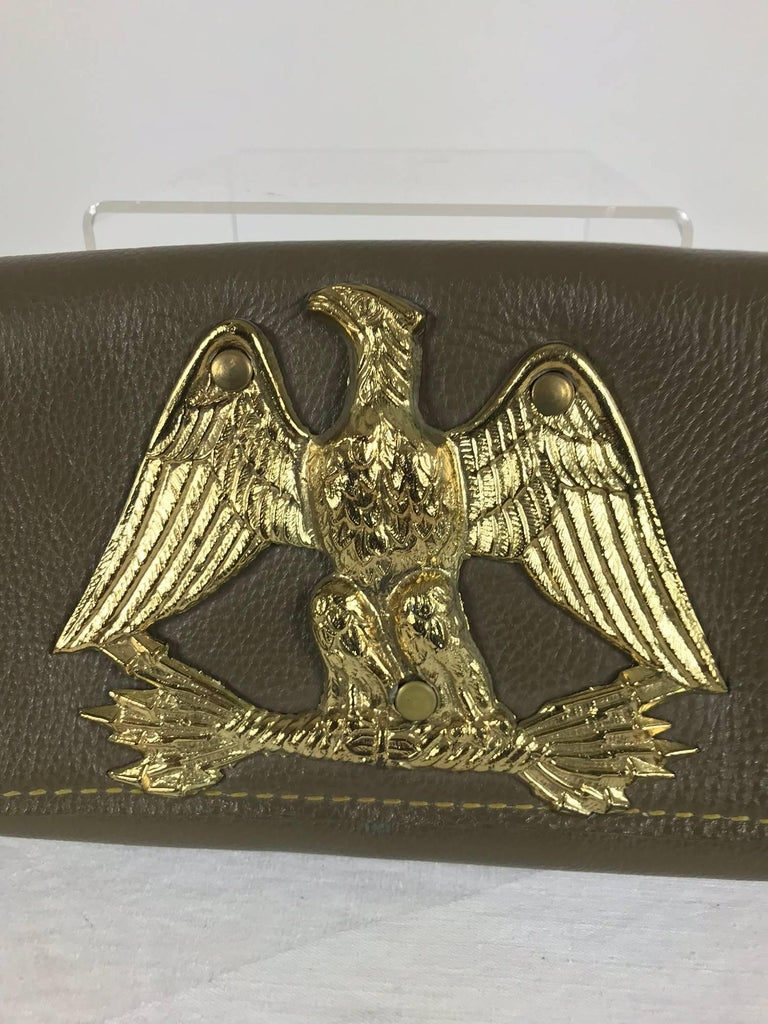 Roger Van S Gold eagle green leather clutch hand bag from the 1950s NWOT. 1940s and 50s fashion model Doris Bryn and husband Roger Van Shoyck began an accessories line after they met at the University of Cincinnati. The labels, Roger Van S. and