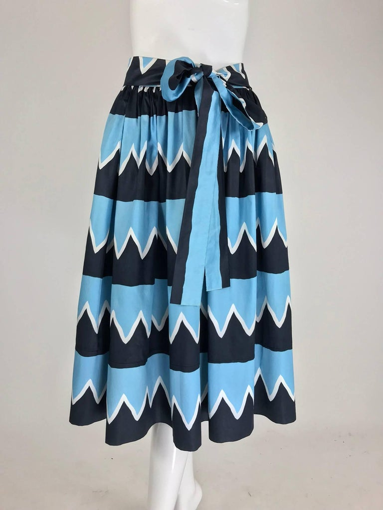Yves Saint Laurent documented cotton skirt 1970s S/S 1980 Rive Gauche. Famously worn by model Iman in the advertisement for Rive Gauche, photographed by David Bailey. This skirt is eye-catching with bold geometric print in blue, black and white. The