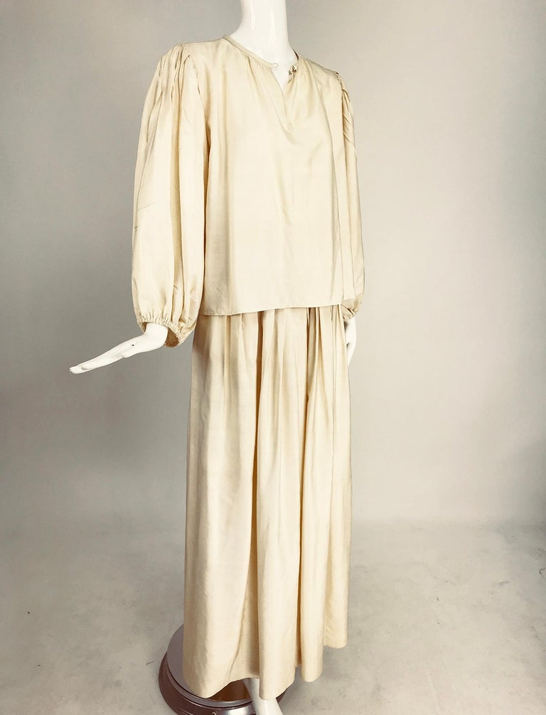 Yves Saint Laurent natural raw silk top and maxi skirt fro the 1970s. Amazing set with a bohemian luxe feel, wear belted with the top tucked in or out. The pull on blouse has long full set in sleeves that are pleated at the shoulder top and cased