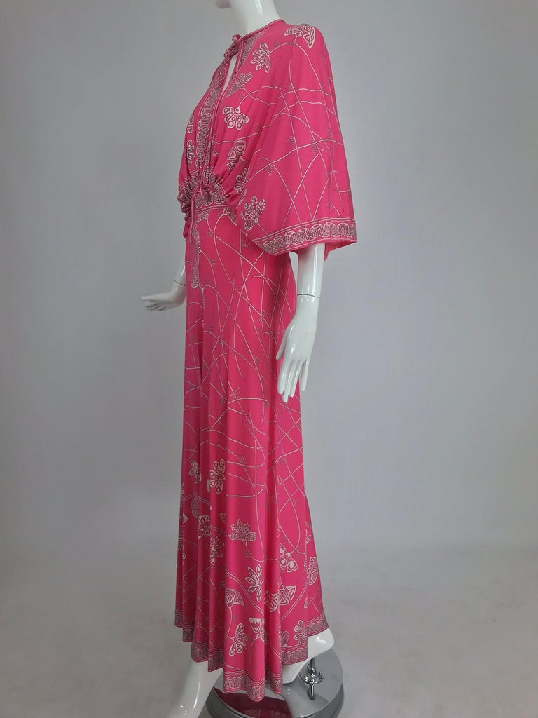 Emilio Pucci flamingo pink silk jersey plunge top and palazzo trouser from the 1970s. This amazing and rare Pucci set has a bat wing, full sleeve top that is open at the center front and back from the neck to the waist, the waist has cased elastic