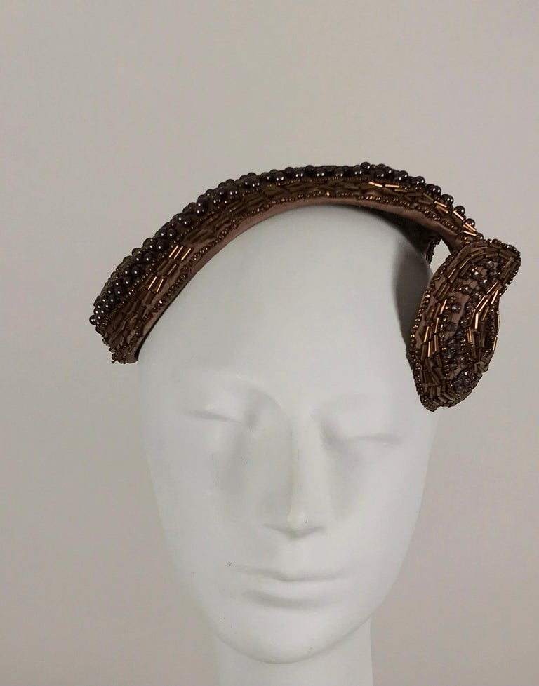Designed by Lora copper beaded cocktail hat from the 1950s. Beautiful and glittery copper tube beads and mat copper round beads are sewn on copper satin, the hat fits like a wide headband, with a shaped
