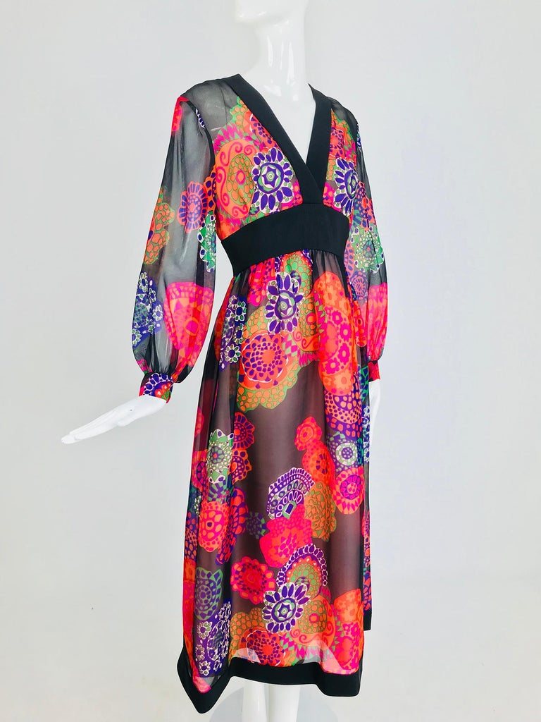 Shannon Rodgers for Jerry Silverman floral silk organza midi dress from the 1970s. I love the print of this dress, the colours are rich and bright set against a black ground This amazing silk organza dress is trimmed in black silk faille. V neckline