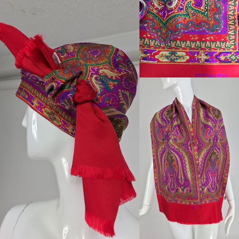 Fendi paisley silk oblong scarf in reds and fuchsia. This beautiful scarf is long and wide and is double with a side seam and self fringe at either end. Looks barely worn. There is a little bit of over printing, looks like a fine dash of gold, see