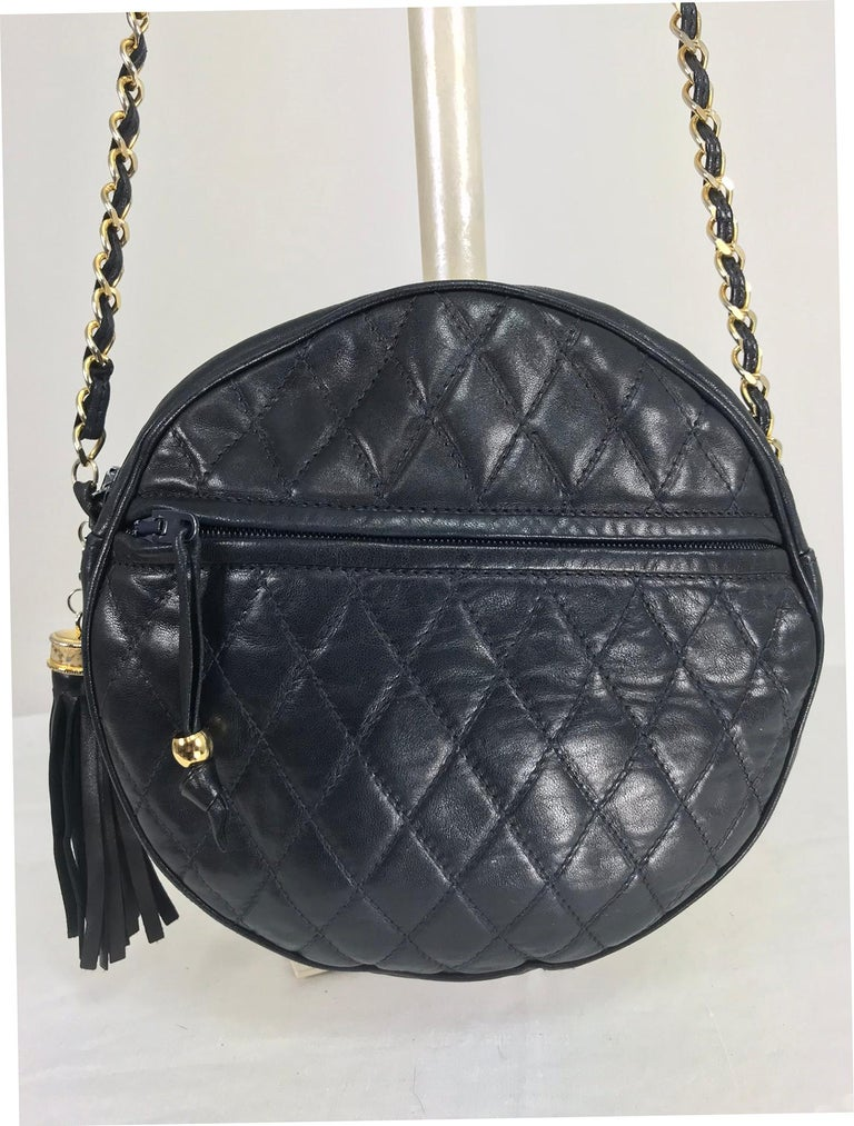 313b07a7a50d SISO Italy round navy lambskin quilted leather shoulder bag from the 1980s.  Buttery soft lambskin