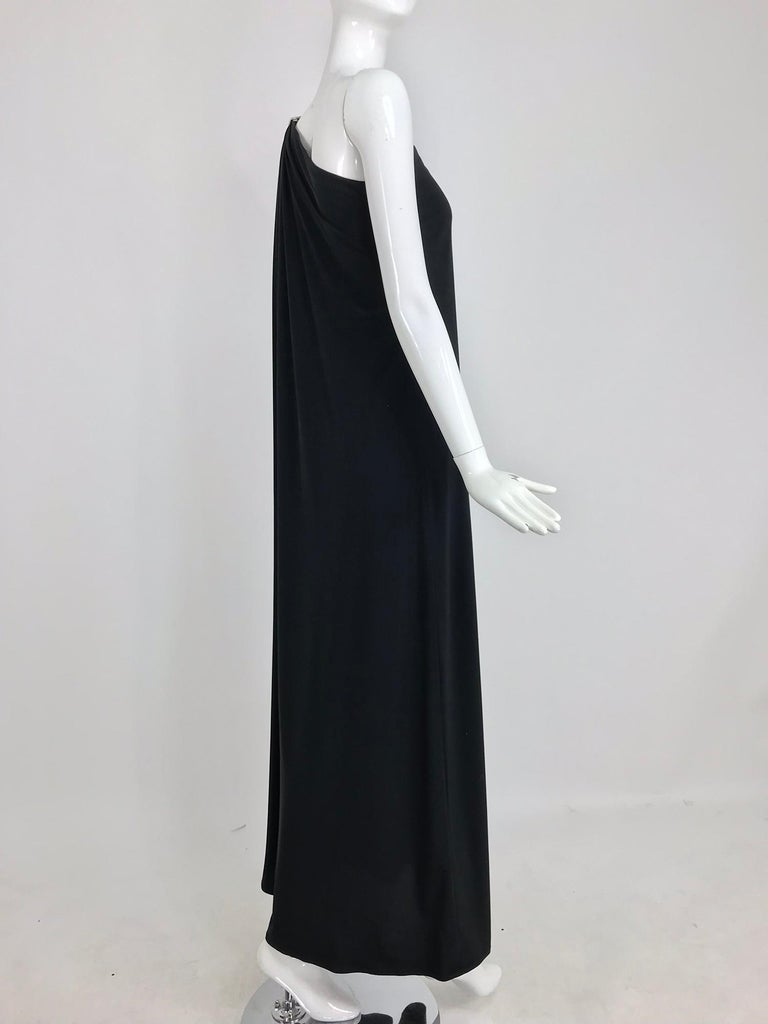 Women's Adele Simpson black jersey one shoulder gown with jewel clasp For Sale