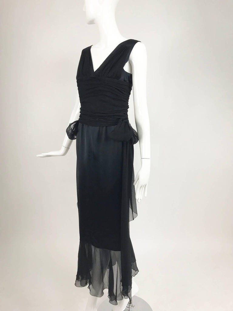 Chanel black silk satin and chiffon evening gown 2006A...A beautiful dress reminiscent of dresses of the Edwardian period...V neck dress with a boned waist bodice of silk satin shoulders with a silk chiffon pleated mid section, the dress is boned at