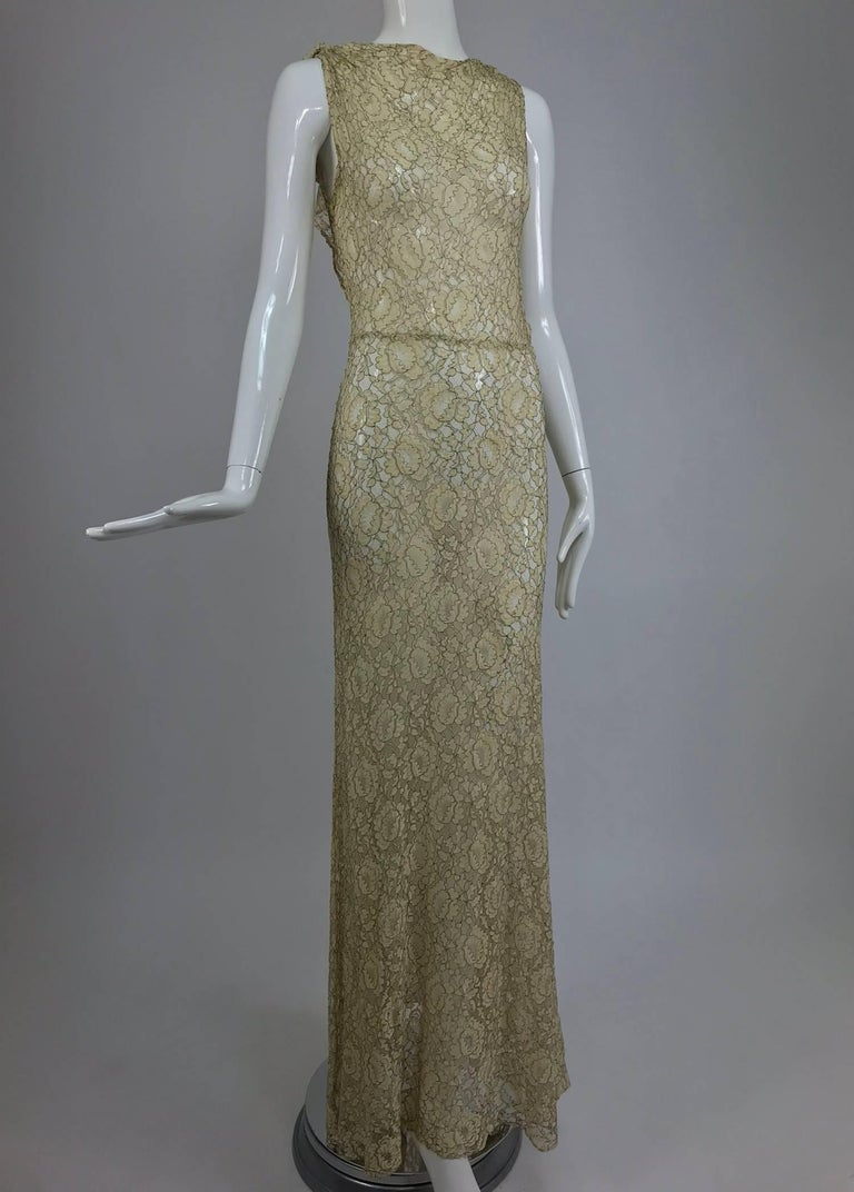 1930s Mixed gold metallic thread cream lace evening dress. This beautiful dress would make an amazing wedding gown. The fabric is cream lace that is re embroidered with gold metallic thread, giving the dress a very golden look. The neckline is cut