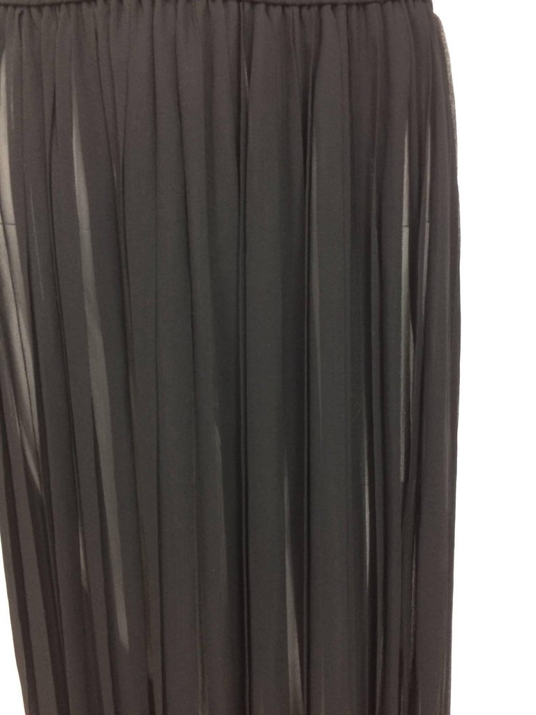 Yves St Laurent knife pleated black silk sheer chiffon maxi skirt from the 1970s. Cased elastic waist. Sexy sheer silk chiffon maxi skirt . Marked size 38  In excellent wearable condition... All our clothing is dry cleaned and inspected for