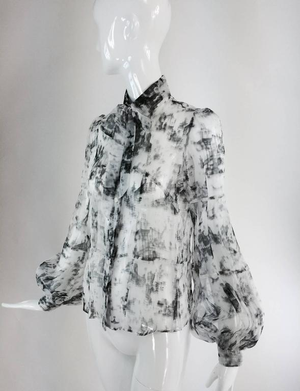 Valentino Hiver 2008 black & white organza blouse...Modern print in shades of gray to black...Fitted blouse with self bow at the collar, placket front with logo buttons, horizontal seaming in the torso...Long sleeves with fullness at the wrist,