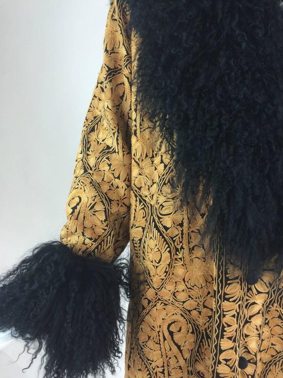 Gold crewel embroidered coat with Mongolian lamb collar & cuffs 1960s...Heavily crewel embroidered coat from the late 1960s or early 70s...Every square inch of this coat is covered in gold chain stitch embroidery in beautiful patterns giving depth