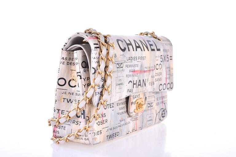 Chanel Medium  Graffiti Logo Newspaper Print Double Flap Bag RUNWAY limited    New Condition   6.3' x 10'x 3' inches  Very Limited Chanel Multicolor Hand painted Lambskin medium flap bag.  Very hard to find. Chanel VIP Limited Edition. A