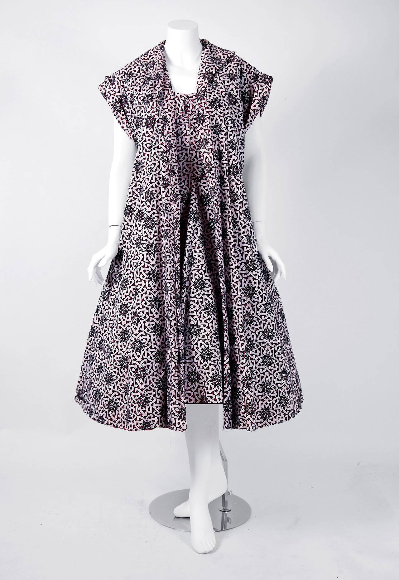 """With its vivid black and white atomic novelty pattern and flawless 'new look' silhouette, this """"Lilli Diamond"""" designer ballerina sundress ensemble has the casual elegance the 1950's were known for. The artisanship alone is unbelievable. A cut-out"""