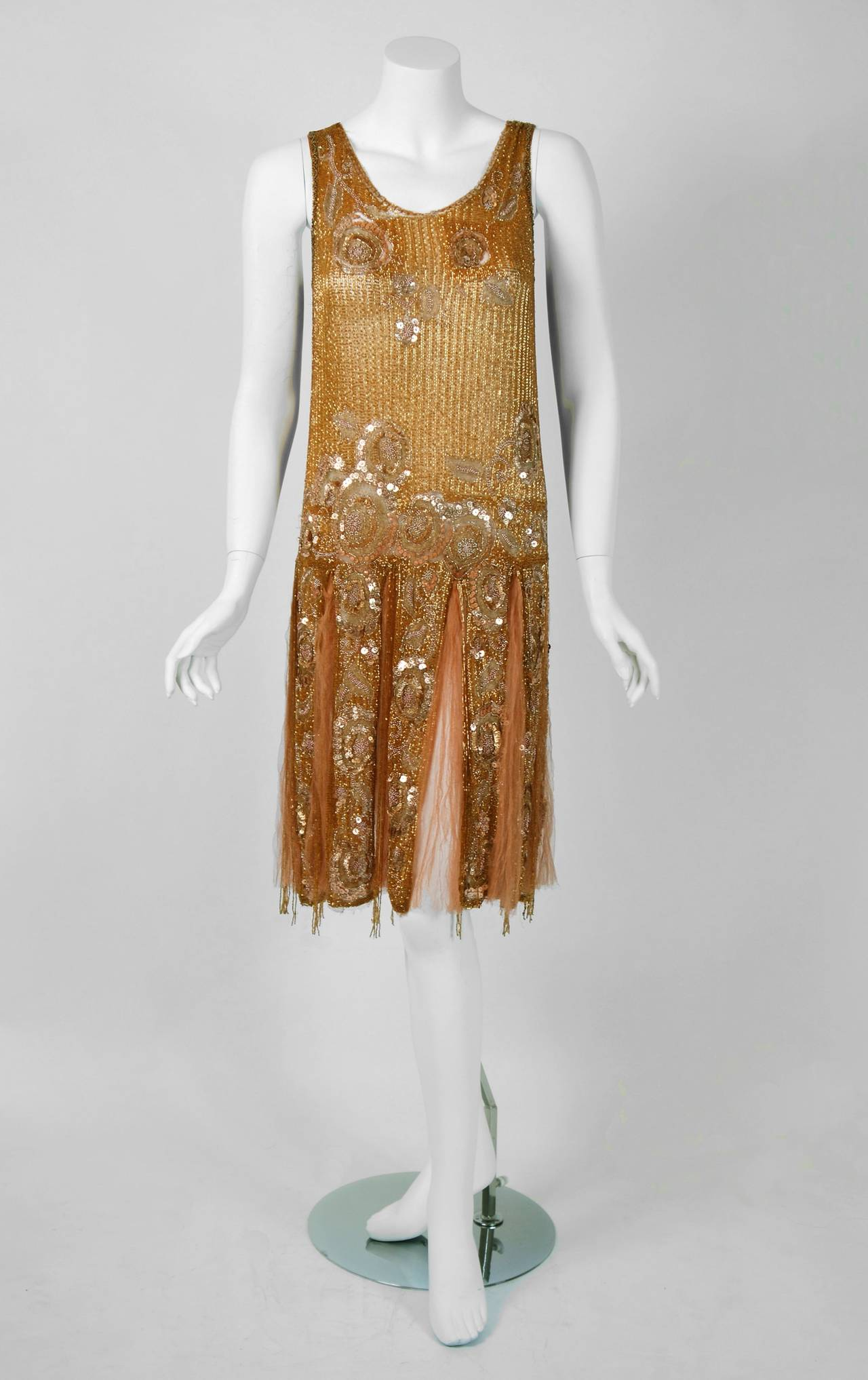 There are lots of lovely 1920's garments still around, but every once in a while I come across one that sets my heart a flutter! This is an extraordinarily beautiful and exceptional 1920's metallic gold couture silk-net dance dress and matching