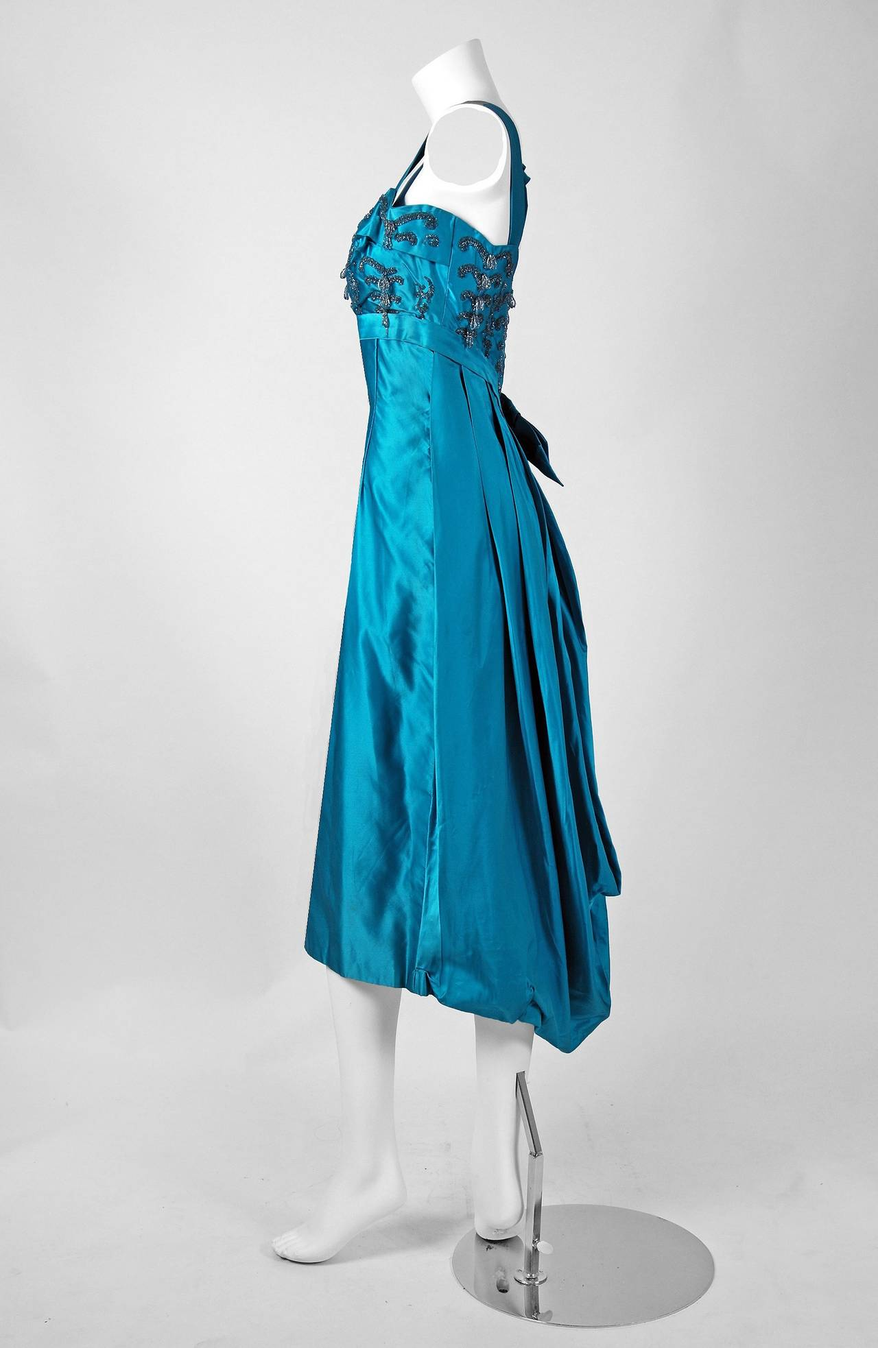 Alluring Ceil Chapman cocktail dress in the most breathtaking turquoise-blue color! I adore the scalloped, beaded shelf-bust boned bodice with adorable shoulder-bow. The unique pencil-skirt has a dramatic back draped-bubble construction which gives