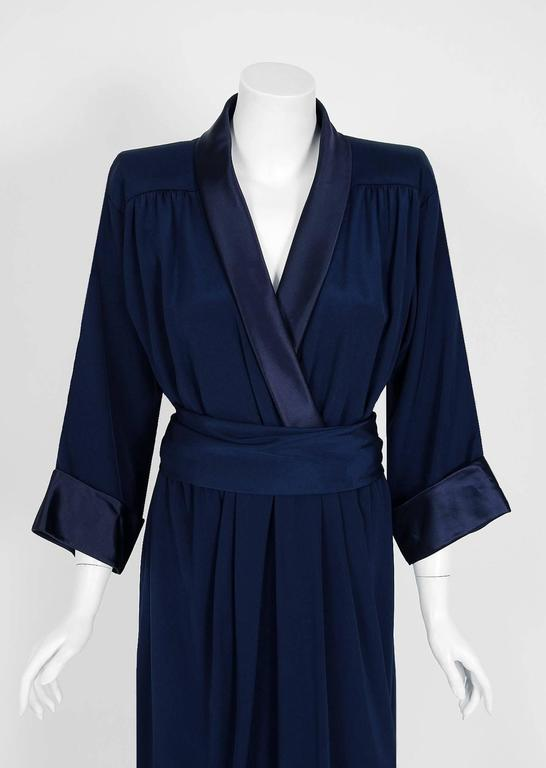 Breathtaking Yves Saint Laurent designer dress from his 1979 collection. Such a rarity to find both pieces together! It is insanely chic with its easy-to-wear wrapped construction. The fabric is a rich navy-blue woven silk complete with liquid satin